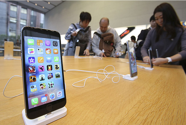 New iPhone 6s models are on display at an Apple store in Tokyo as Apple Inc. launched the sales of the latest models of its popular smartphone in Japan Friday, Sept. 25, 2015. Apple is counting on sales of the new iPhones to maintain its position as one of the most profitable, and valuable, companies in the world. (AP Photo/Koji Sasahara)