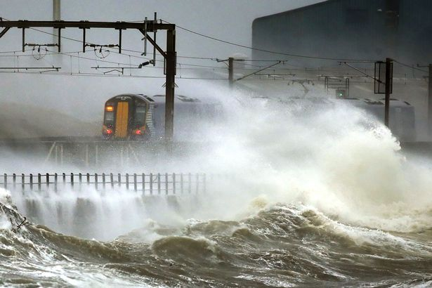 a-train-passes-through-the-coast-at-saltcoats-in-scotland