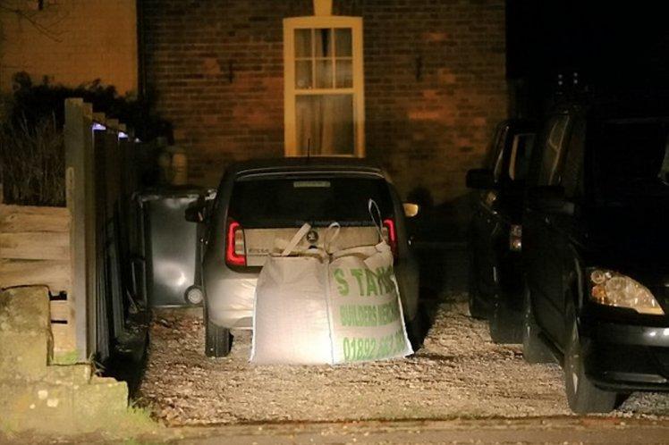 An angry resident placed a tonne of gravel behind a commuter's car after he parked in her private driveway. See SWNS story SWGRAVEL; A grumpy home owner got so fed up with a commuter parking on her drive she blocked their car in - with a tonne of GRAVEL. Revenge was sweet for Julie Geue, 48, who was so infuriated when a commuter parked on her four-car driveway, she took matters into her own hands. Her driveway was due to be gravelled when the man parked in her drive, meaning works could not carried out, so she ordered builders to place the tonne of gravel behind the car, blocking it in for two days before it was moved. Julie, from Crowborough, East Sussex, lives opposite Farningham Road train station. She explained that the driver, who returned to his car after work claimed he was meant to be parking at a friend's house, but got confused.