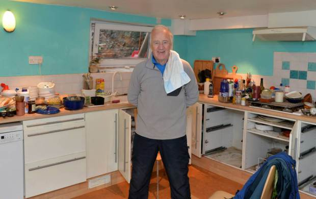 Peter Clarkson from Kendal Swiming in his Flooded House nPix Dave Nelson