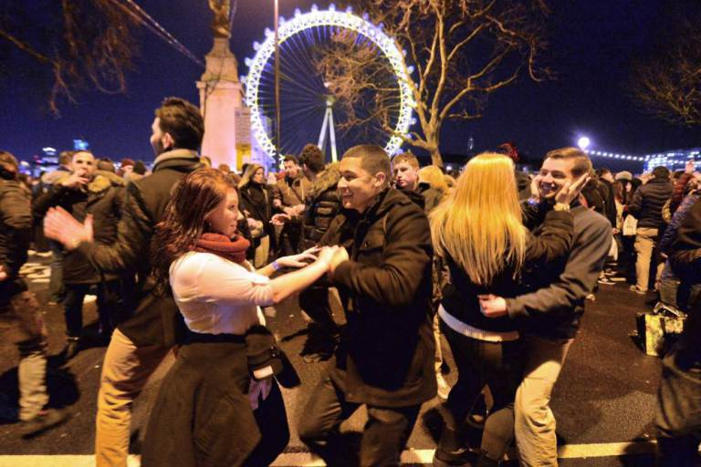 Revellers in central London during the New Year celebrations. PRESS ASSOCIATION Photo. Picture date: Thursday December 31, 2015. Photo credit should read: Anthony Devlin/PA Wire
