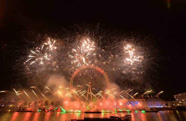 Fireworks light up the sky over the London Eye in central London during the New Year celebrations. PRESS ASSOCIATION Photo. Picture date: Friday January 1, 2016. Photo credit should read: Anthony Devlin/PA Wire