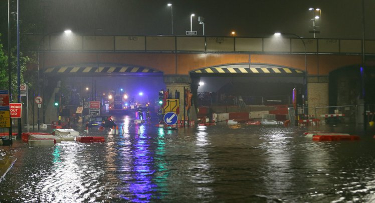 After extremely wet weather all night in London a major flood is seen here shutting part of the A20 in & out of London in the centre of Lewisham outside Lewisham Rail Station. Police & Fire Brigade was on the scene trying to sort out the issue but several cars were stuck in the flood water & required assistants.   11 May 2016. Please byline: Weir/Vantagenews.com
