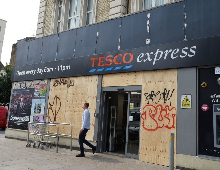 Properties, shops and restaurants on the route of the Notting Hill Carnival are boarded up in preparation, as shop-keepers and residents aim to protect their property over the Sunday and Monday, of the Carnival in north west London.PRESS ASSOCIATION Photo. Picture date: Saturday August 27, 2016. Photo credit should read: John Stillwell/PA Wire