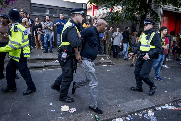 A fight breaks out at the annual Notting Hill Carnival, at Notting Hill in London. Credit: Euan Cherry/UPPA