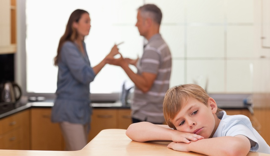 little-boy-hearing-his-parents-arguing-in-a-kitchen