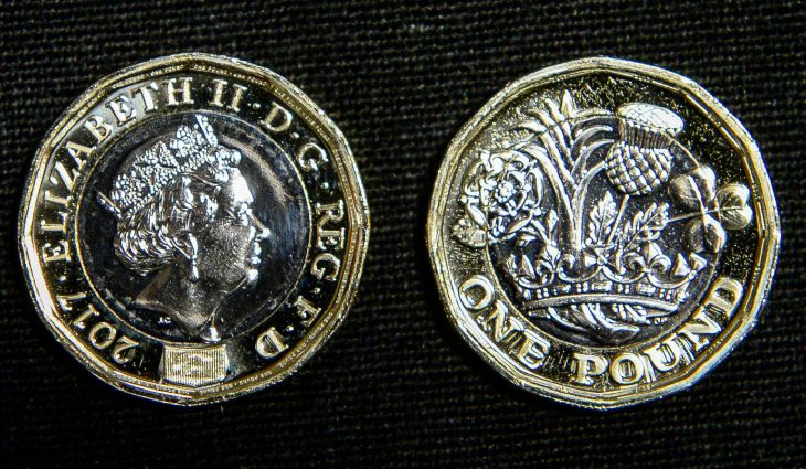 14/03/17 PA File Photo of both faces of the 12-sided one pound coin at the Royal Mint in Llantrisant, Wales. See PA Feature FINANCE New Pound. Picture credit should read: Ben Birchall/PA Photos. WARNING: This picture must only be used to accompany PA Feature FINANCE New Pound