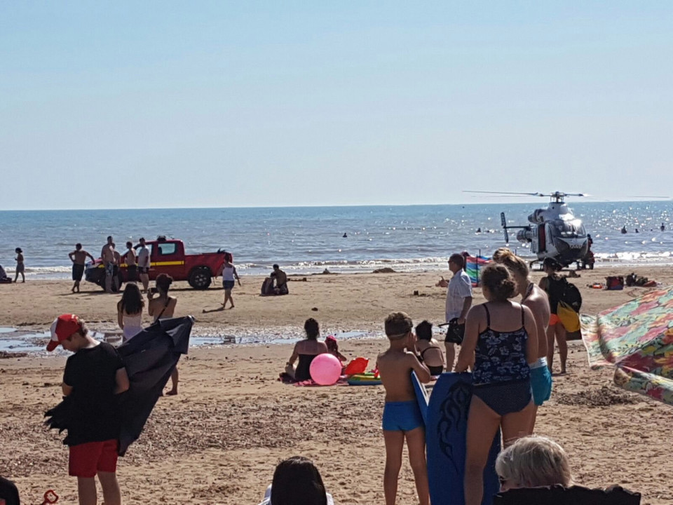 """Coastguard and air ambulance at the scene in Camber Sands after reports three people were pulled from the sea. See National News story NNSANDS; Three swimmers were rescued from the sea as bathers looked on in shock today (Weds). Two rescue helicopters were scrambled to help the trio, who were given CPR treatment on the packed beach. The air ambulance and the search and rescue coastguard helicopters landed at the scene in Camber Sands, Kent shortly before 2.30pm. Paramedics gave emergency treatment to the casualties on the sand, while helicopters circled in the sky above. A spokesman for the Maritime and Coastguard Agency said they received a report at 2.15pm that """"three people required urgent medical attention"""". Helicopters from Lydd and Lee-on-Solent in Hampshire were called. The spokesman added: """"There is also a Senior Coastal Operations Officer on scene. An air ambulance has also been sent to the location. *** Local Caption ***"""