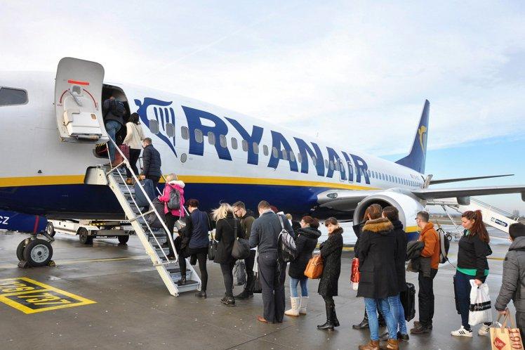 STANSTED, THE UNITED KINGDOM, 26.01.2016 - Passengers boarding on Ryanair flight.; Shutterstock ID 371091458