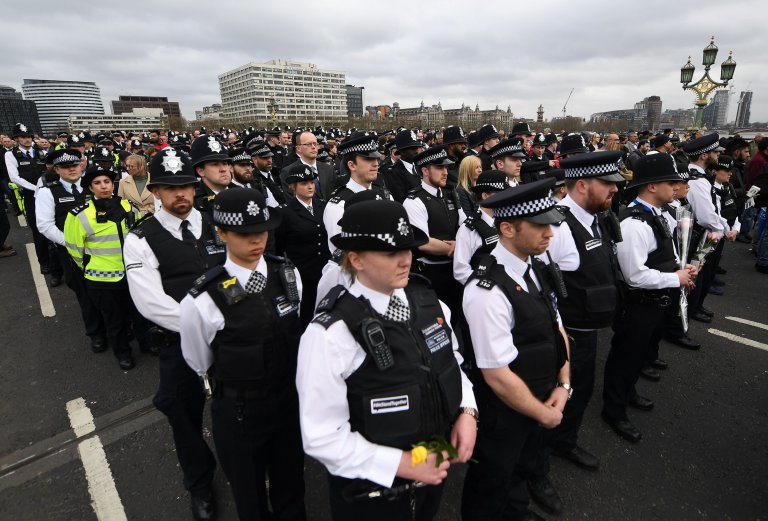 epaselect epa05877367 London Police officers join members of the public to hold a vigil on Westminster Bridge in central London, Britain, 29 March 2017, one week after the Westminster terror attack. Hundreds of people arrived at Westminster Bridge to remember the people who lost lives in the terror attack on 22 March in Westminster leaving five people dead, including the attacker, and 50 people injured.  EPA/ANDY RAIN